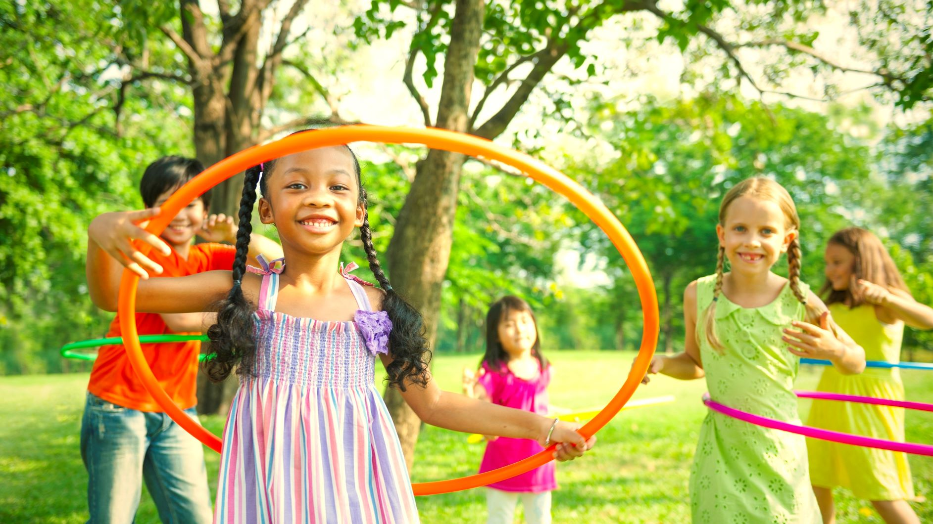 cute-diverse-kids-playing-with-hula-hoops-NT5EF8M.jpg