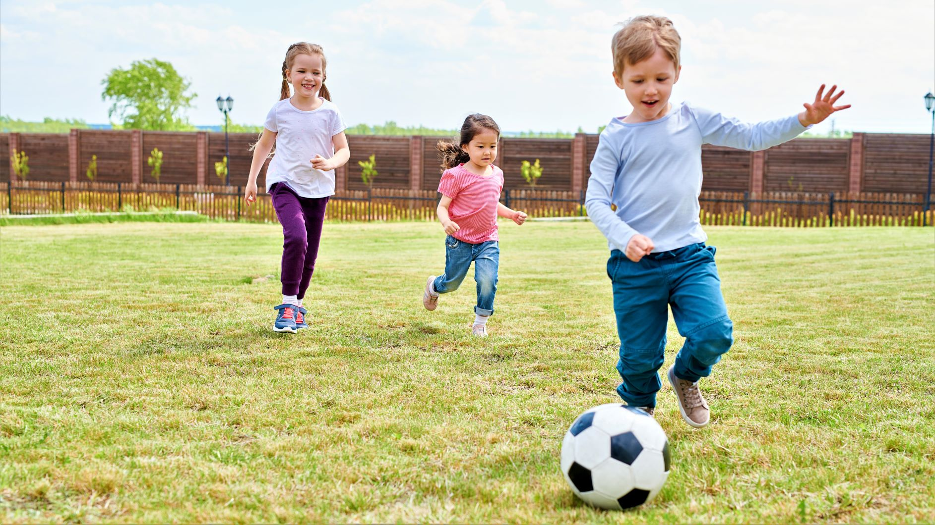 kids-playing-football-CDGA7WR.jpg