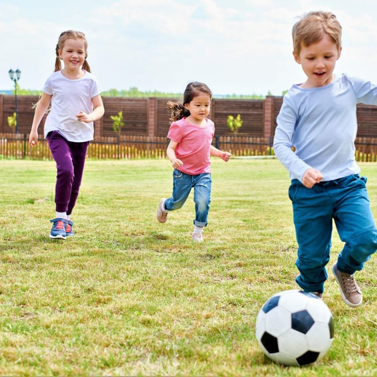 kids-playing-football-CDGA7WR.jpg
