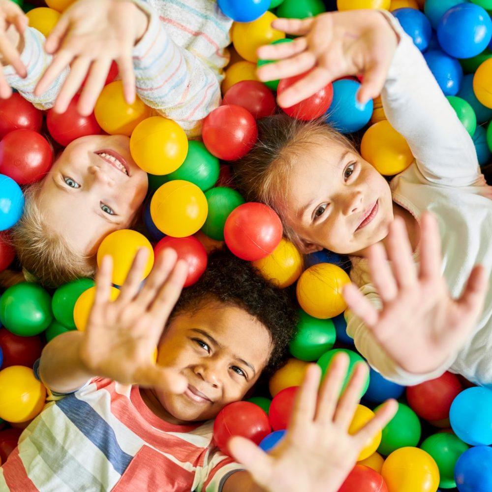 three-kids-playing-in-ballpit-3RTMYS8.jpg